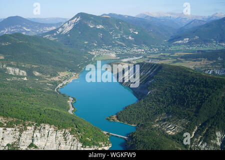UPPER PART OF LAKE CASTILLON WITH THE TOWN OF SAINT-ANDRÉ LES ALPES AT THE VERY END (aerial view). Alpes de Haute-Provence, France. - Stock Photo