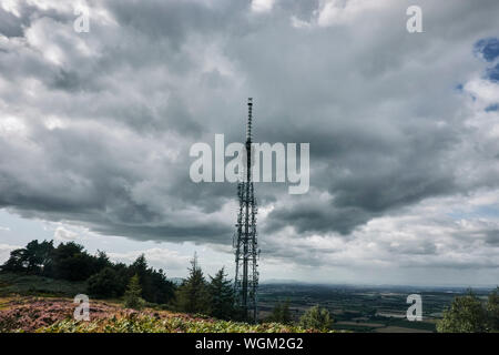 Communications tower on top of a hill - Stock Photo