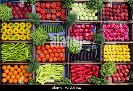 High Angle View Of Various Vegetables And Fruits For Sale At Market Stall - Stock Photo
