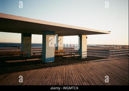 View Of Boardwalk On Beach Against Clear Sky