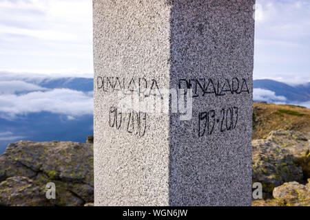Stone post with the name of the top of the mountain of Peñalara, Madrid. - Stock Photo