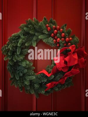Close-up Of Christmas Wreath On Wooden Door - Stock Photo