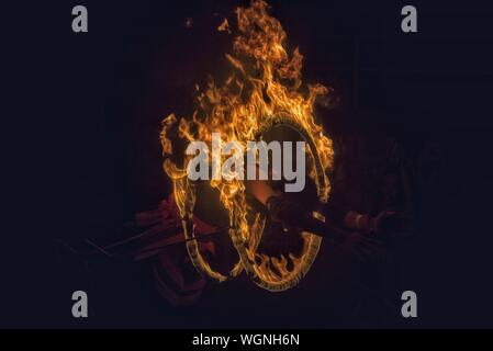 Man Performing With Fire At Night - Stock Photo
