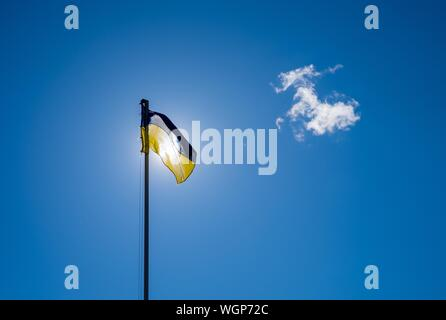 Low Angle View Of Ukrainian Flag Against Sky - Stock Photo