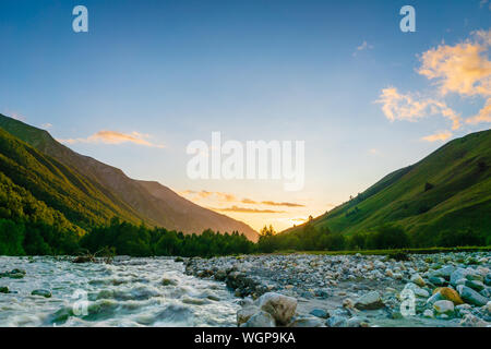 Svaneti landscape at sunset with mountains and river on the trekking and hiking route near Mestia village in Svaneti region, Georgia.
