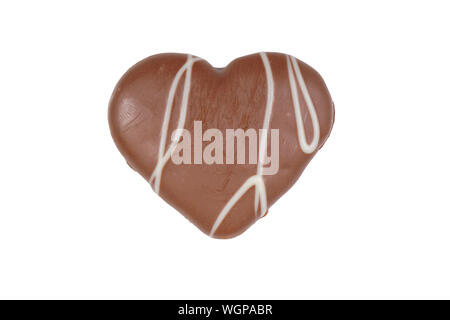 Close-up Of Heart Shape Chocolate Cookie Against White Background - Stock Photo