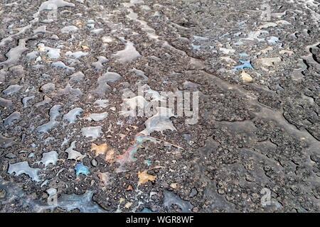 Full Frame Of Oil Spills On Road - Stock Photo
