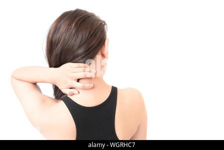Rear View Of Young Woman With Itching And Neckache Against White Background - Stock Photo