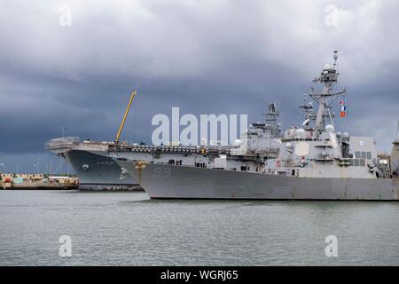 190830-N-QI061-4265  JACKSONVILLE, Fla. (Aug. 30, 2019) The Arleigh Burke-class guided-missile destroyer USS Farragut (DDG 99) departs from Naval Station Mayport as Commander, U.S. 4th Fleet orders all U.S. Navy ships homeported in the area to sortie ahead of Hurricane Dorian, which is forecasted to bring high winds and heavy rain to the East Coast. Ships are being directed to areas in the Atlantic where they are best postured for storm avoidance. (U.S. Navy photo by Mass Communication Specialist 3rd Class Nathan T. Beard/Released) - Stock Photo