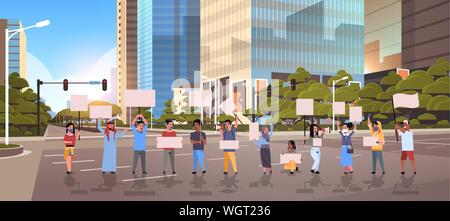 people protesters holding blank placards men women activists with empty banners on asphalt road protest demonstration strike concept modern city - Stock Photo