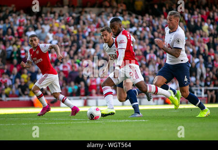 London, UK. 1st Sep, 2019. Arsenal's Alexandre Lacazette (2nd R) shoots to score during the English Premier League north London Derby match between Arsenal and Tottenham Hotspur at Emirates Stadium in London, Britain on Sept. 1, 2019. Credit: Han Yan/Xinhua/Alamy Live News - Stock Photo