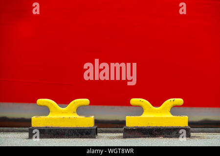 Close-up Of Yellow Mooring Hooks On Jetty - Stock Photo