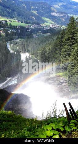Scenic View Of Rainbow Over Krimml Waterfalls - Stock Photo