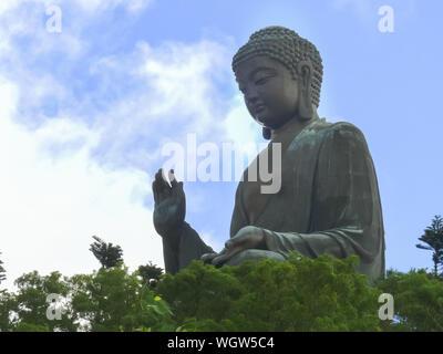HONG KONG, CHINA- SEPTEMBER, 30, 2017: side view of tan tian buddha in hong kong - Stock Photo