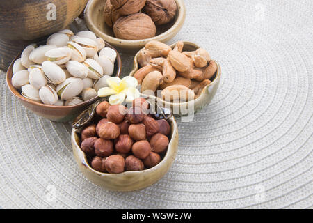 Close-up Of Dried Fruits In Bowls On Table - Stock Photo