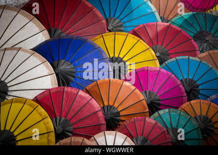 Full Frame Shot Of Multi Colored Paper Umbrellas For Sale At Market - Stock Photo