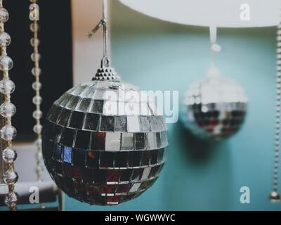 Close-up Of Crystal Decorations Hanging At Home - Stock Photo