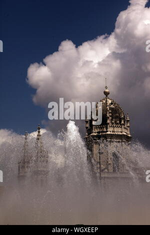 View Of Mosteiro Dos Jeronimos In Fountain Against Cloudy Sky - Stock Photo