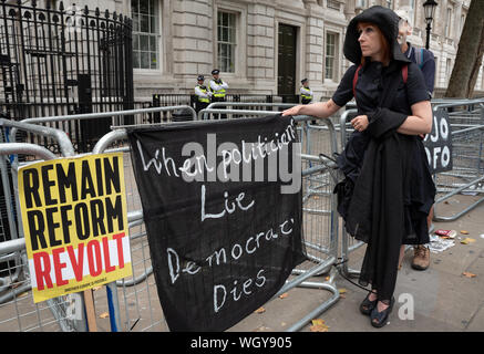 London, UK. 31st August 2019. Stop The Coup demonstration against PM Boris Johnson's use of prorogation to curtail parliamentary time and increase the chance of a Brexit no deal. Downing Street, woman dressed in black with black banner stating When politicians Lie Democracie Dies. Credit: Stephen Bell/Alamy - Stock Photo