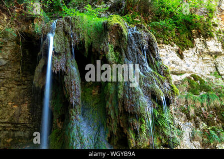 Tannegger Waterfall with its bizarre tufa formation in the Wutach Gorge Nature Reserve, Black Forest, Baden-Württemberg, Germany - Stock Photo