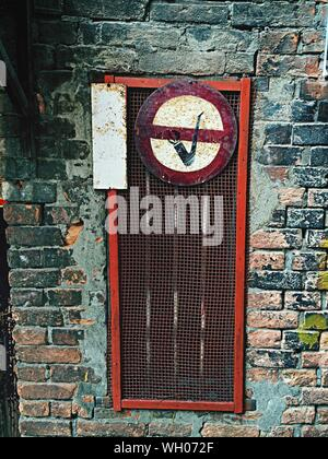 No Smoking Sign On Wall - Stock Photo