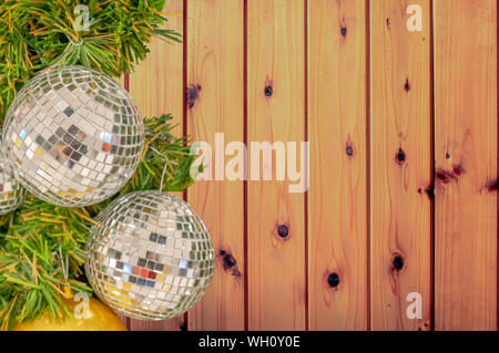 Glass ball ornaments on a Christmas tree Background Plywood Floor With Wood Pattern with clipping path. - Stock Photo