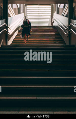 Low Angle View Of Woman Walking On Stairs - Stock Photo