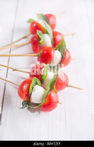 Close-up Of Mozzarella Cheese With Tomato In Sticks