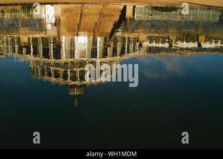 Reflection Of Built Structure In Lake Against Sky - Stock Photo