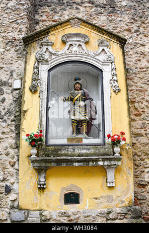 Lisbon, Portugal - July 27, 2019: Statue of Saint George in the entrance of the Sao Jorge (St. George) Castle - Stock Photo