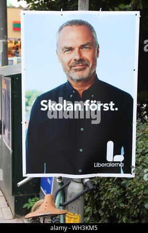 STOCKHOLM, SWEDEN - AUGUST 22, 2018: Liberals (Liberalerna) political poster before Swedish general election (scheduled for September 9, 2018). - Stock Photo