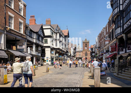 Chester Rows and street scene with shoppers in pedestrianised historic city centre in summer. Bridge Street, Chester, Cheshire, England, UK, Britain - Stock Photo
