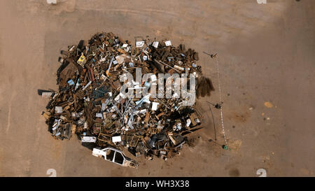 a pile of garbage from scrap metal top view aerial photography from a drone - Stock Photo