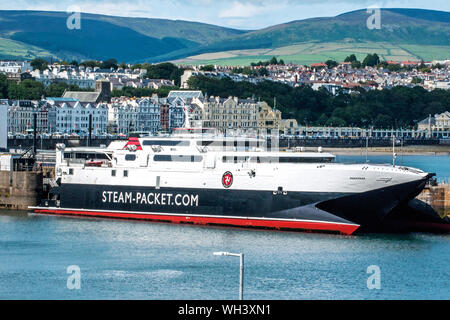 High-speed ferry Manannan at her berth in Douglas Harbour, Isle of Man.She is named after an Irish mythological Sea God. - Stock Photo