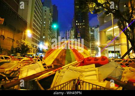 Hong Kong, China. 31st, August 2019. Riots escalates in different districts after the unauthorized peaceful rally. Here protesters set up the barriers to block Hennessy Road at Wan Chai. - Stock Photo
