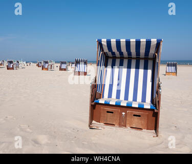 beach korbs on the island of norderney in germany on sunny day - Stock Photo