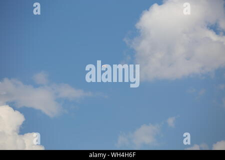 Low Angle View Of Paraglider In Sky - Stock Photo