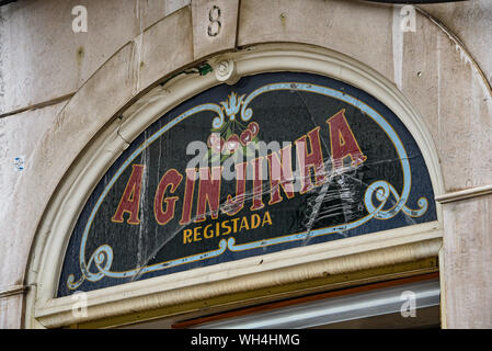 Lisbon, Portugal - July 27, 2019: 'A Ginginha', a famous bar dedicated to Ginginha, a traditional Sour Cherry Brandy - Stock Photo