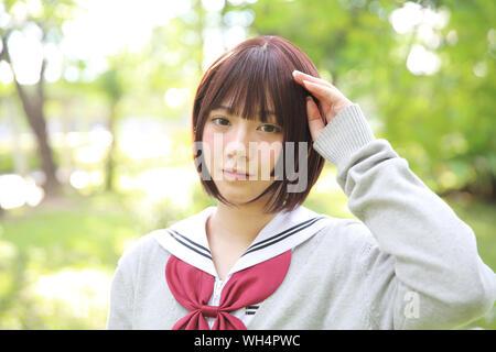 Portrait Of Beautiful Young Woman Wearing Japanese School Uniform - Stock Photo