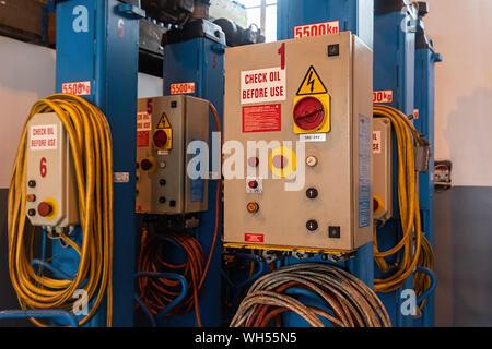 Auto hydraulic heavy duty jack for trucks, in a workshop warehouse. - Stock Photo