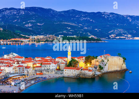 Budva, Montenegro. Panoramic view of old town in the evening. - Stock Photo