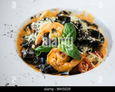 High Angle View Of Fettuccine With Shrimps Served In Plate On Table