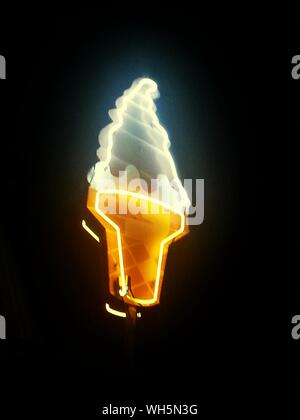 Low Angle View Of Ice Cream Neon Sign Against Clear Sky At Night - Stock Photo