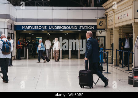 London, UK - July 18, 2019: People walking in front of the entrance to London Marylebone underground station. It is connected to an railway station of - Stock Photo