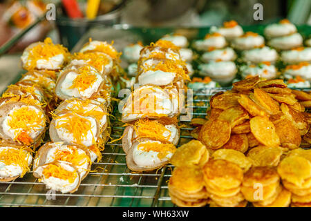 Khanom Buang - Thai traditional dessert, crispy pancake made with cream and Foi Thong (egg golden threads) on top. Thai street food. Bangkok, Thailand. - Stock Photo