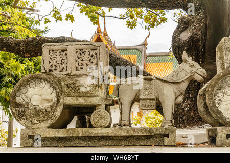 Stone carved carriage with a horse at Wat Suthat Thepwararam, old royal Buddhist temple (wat) in Bangkok, Thailand. - Stock Photo