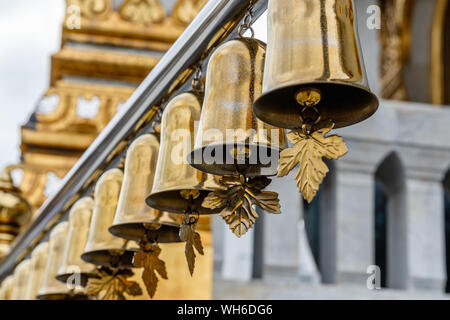 Golden bells at Buddhist temple Wat Traimit, Bangkok, Thailand. - Stock Photo
