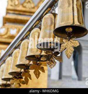 Golden bells at Buddhist temple Wat Traimit, Bangkok, Thailand. Square image. - Stock Photo