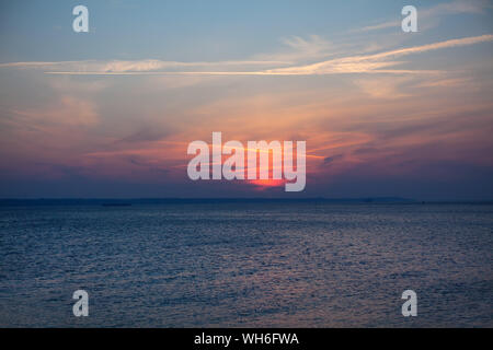 fantastic sunset over the calm sea - Stock Photo