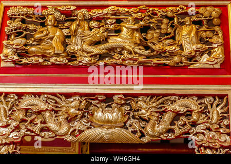 Gold painted carving at Wat Mangkon Kamalawat or Wat Leng Noei Yi, largest and most important Chinese Buddhist temple in Bangkok, Thailand - Stock Photo